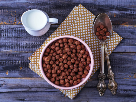 chocolate cereal: Chocolate cereal balls in bowl and milk. Selective focus