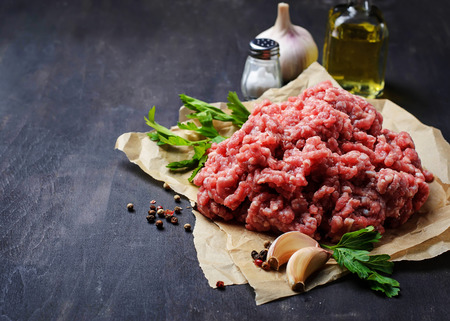 Raw minced meat with olive oil and garlic. Selective focus