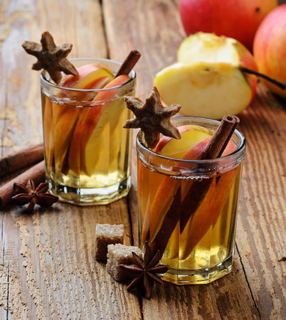 punch spice: Apple cider with cinnamon. Selective focus Stock Photo