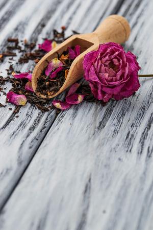 elites: Dried tea with rose petals. Selective focus