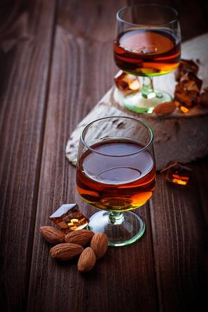 amaretto: Almond liquor amaretto and almonds. Selective focus