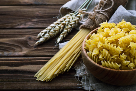 unboiled: Various types of uncooked Italian pasta. Selective focus