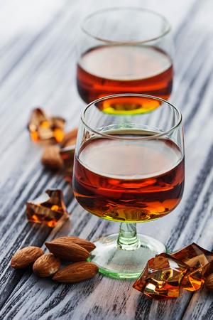 Almond liquor amaretto and almonds. Selective focus