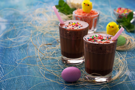 Chocolate Easter drink on blue background. Selective focus 免版税图像