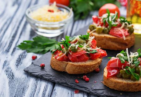 Traditional Italian antipasti bruschetta with pepper, peas and cheese Reklamní fotografie