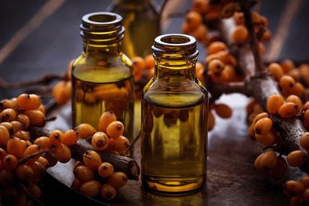 nutrients: Sea buckthorn oil in small bottles. Selective focus