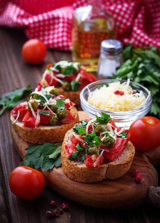 antipasti: Traditional Italian antipasti bruschetta with pepper, peas and cheese