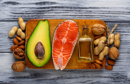 nutrition health: Healthy fat salmon, avocado, oil, nuts. Selective focus