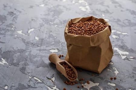 Buckwheat groats in paper bag. Selective focus
