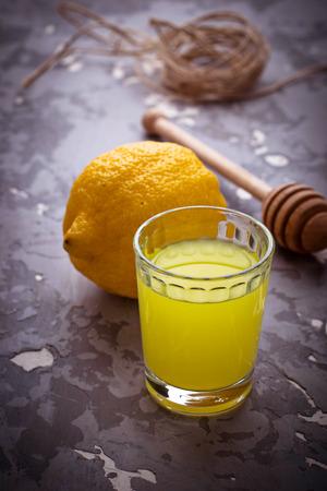 liqueur: Limoncello, Italian liqueur with lemons. Selective focus