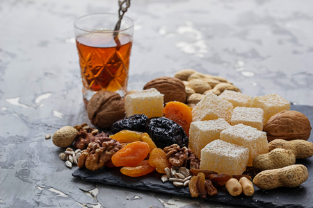 frutas secas: Traditional arabic tea and dry fruits and nuts. Selective focus Foto de archivo