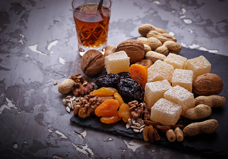 shvat: Traditional arabic tea and dry fruits and nuts. Selective focus Stock Photo