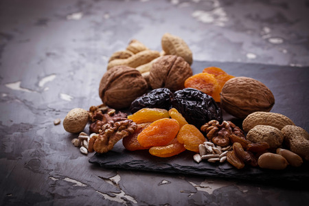 shvat: Mix of dried fruits, nuts and seeds. Selective focus