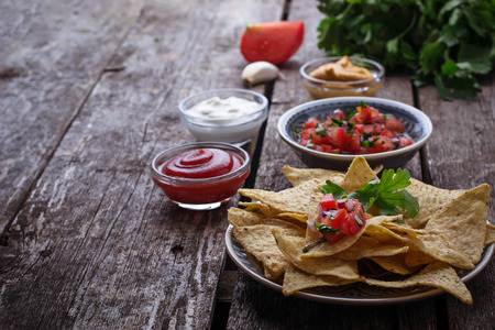 corn chips: Mexican corn chips nachos with salsa dip. Selective focus Stock Photo