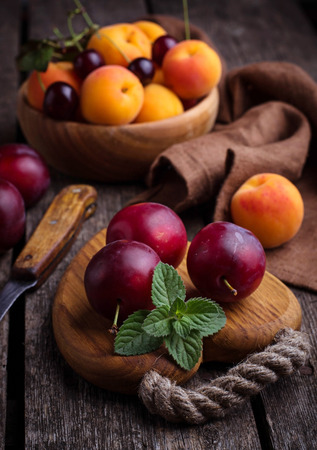 Sweet plums and apricots. Selective focus