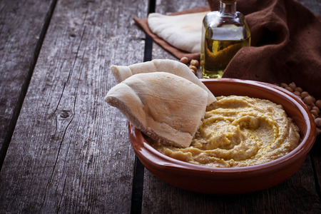pita: Traditional hummus and pita bread. Selective focus Stock Photo