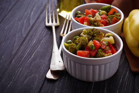 ragout: Vegetable ragout with tomato, broccoli, peas, pepper. Selective focus