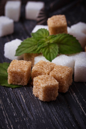 White and brown sugar. Selective focus