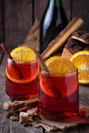 punch spice: Glasses of mulled wine with orange and cinnamon. Selective focus