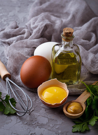 Ingredient for cooking  mayonnaise:  olive oil, eggs, mustard, lemon. Selective focus Stock Photo