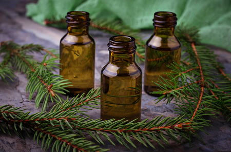 Fir tree essential oil in small bottles. Selective focus