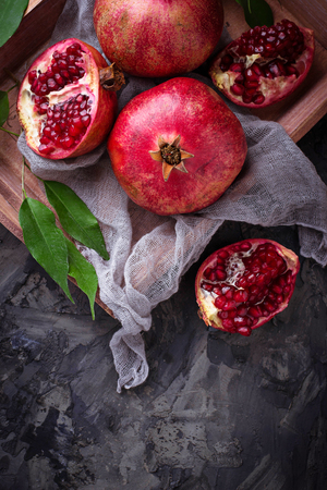 garnets: Ripe dissected pomegranates. Selective focus Stock Photo