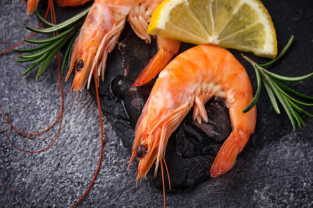 argentinean: Prawns shrimps with lemon and rosemary. Selective focus Stock Photo
