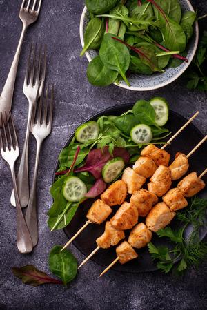 Chicken shish kebabs with green salad. Selective focus Stock Photo