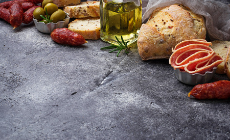 cooking oil: Italian ciabatta bread with olives and salami. Selective focus Stock Photo