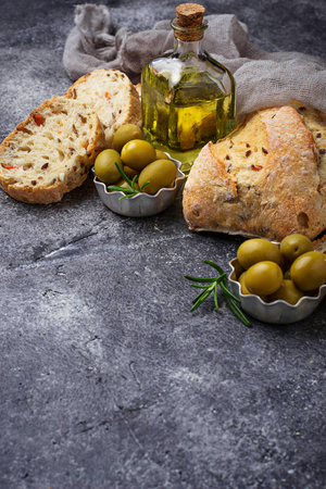 cooking oil: Italian ciabatta bread with olives. Selective focus
