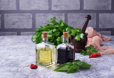 Olive oil and vinegar in glass bottles. Selective focus