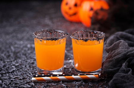 Halloween pumpkin orange cocktails. Festive drink