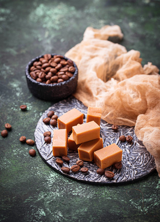 Fudge toffee candy with coffee beans. Selective focus