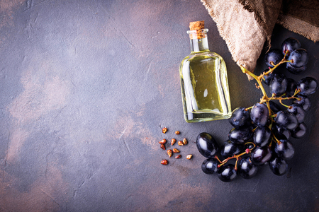 Grape seeds oil in small bottles Stock Photo