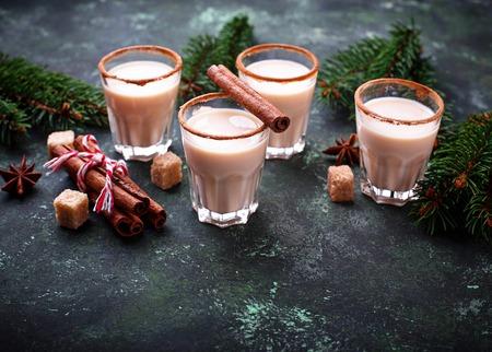 Christmas cocktail eggnog with cinnamon and grated nutmeg. Selective focus