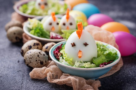Salad with eggs in shape of chickens. Festive food. Selective focus Stock Photo