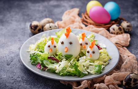 Salad with eggs in shape of chickens. Festive food. Selective focus Stock Photo - 92760507