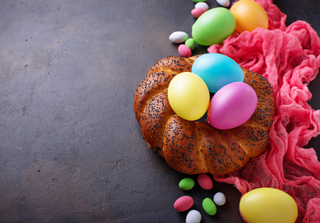 Colorful Easter eggs and wicker bread Stock Photo