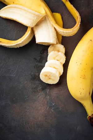 Fresh sliced banana on dark background