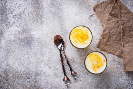 Healthy detox turmeric latte. Golden milk. Stock fotó