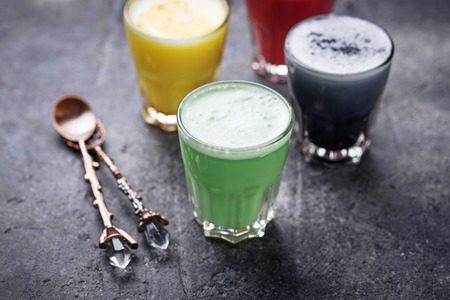 Colorful super lattes with charcoal, beetroots, matcha tea and turmeric. Selective focus Stock fotó