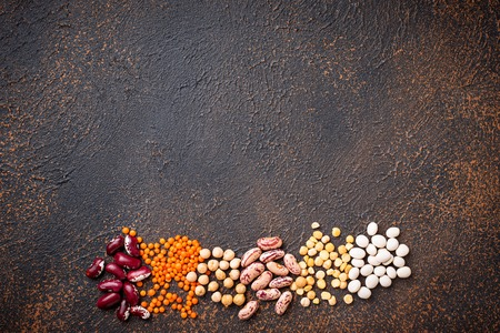 Various legumes. Chickpeas, red lentils, yellow peas and beans. Top view