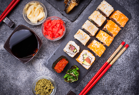 Sushi and roll set on black table. Top view Stock Photo