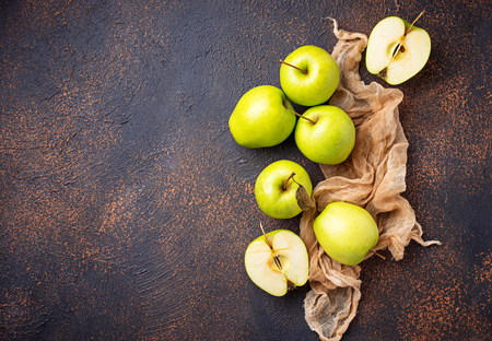 Fresh green apples on rusty background. Top view