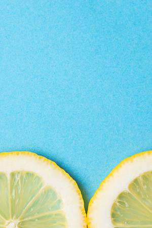 Sliced lemon on blue background