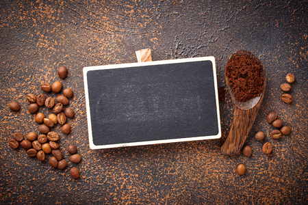 Roasted beans and ground coffee with chalk board Stock fotó