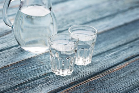 Glasses and jug of cold water Banco de Imagens