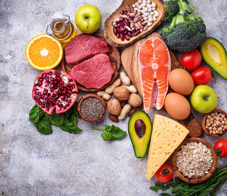 Healthy food and superfood background. Meat, fish, legumes, nuts, seeds, greens, oil and vegetables. Top view, copy space Stockfoto