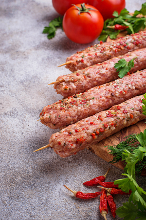 Minced meat skewers lula kebab on light background