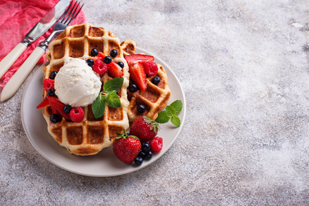 Belgium waffles with berries and ice cream Фото со стока